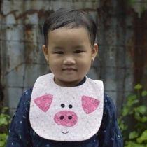 Bavoir petit cochon rose