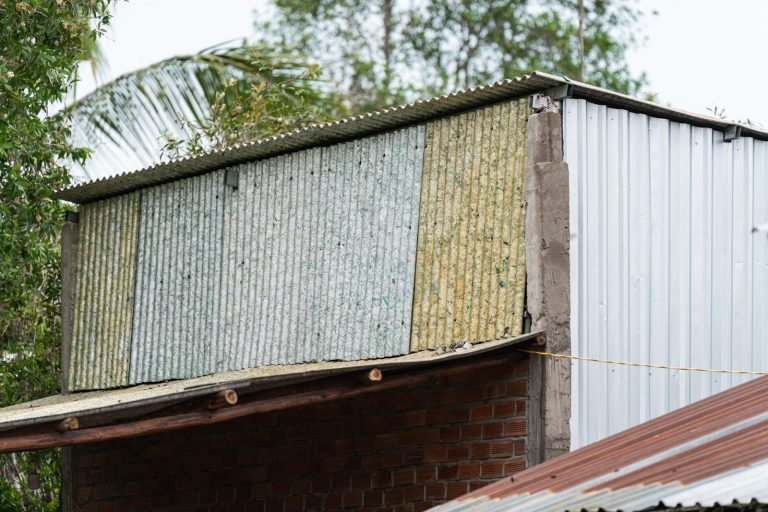 A house covered in recycled panels in a rural village of Vietnam