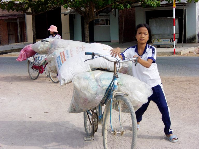 Kids participating in a plastic waste collect in a rural village of Vietnam